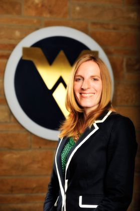 smiling. blonde woman in suit